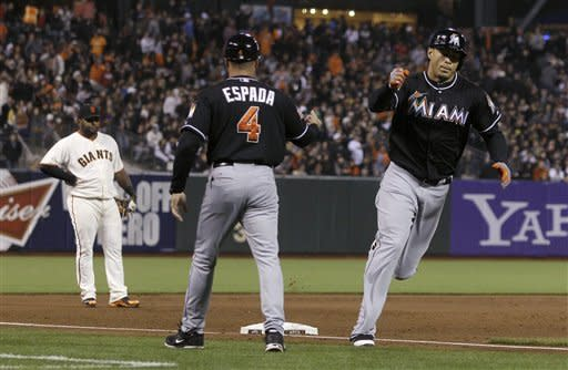 Marlins travel cross country and beat Giants 2-1