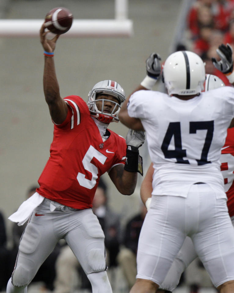 Ohio State quarterback Braxton Miller (5) passes under pressure from Penn State defender Jordan Hill (47) in the first half of an NCAA college football game on Saturday, Nov. 19, 2011, in Columbus, Ohio. (AP Photo/Jay LaPrete)