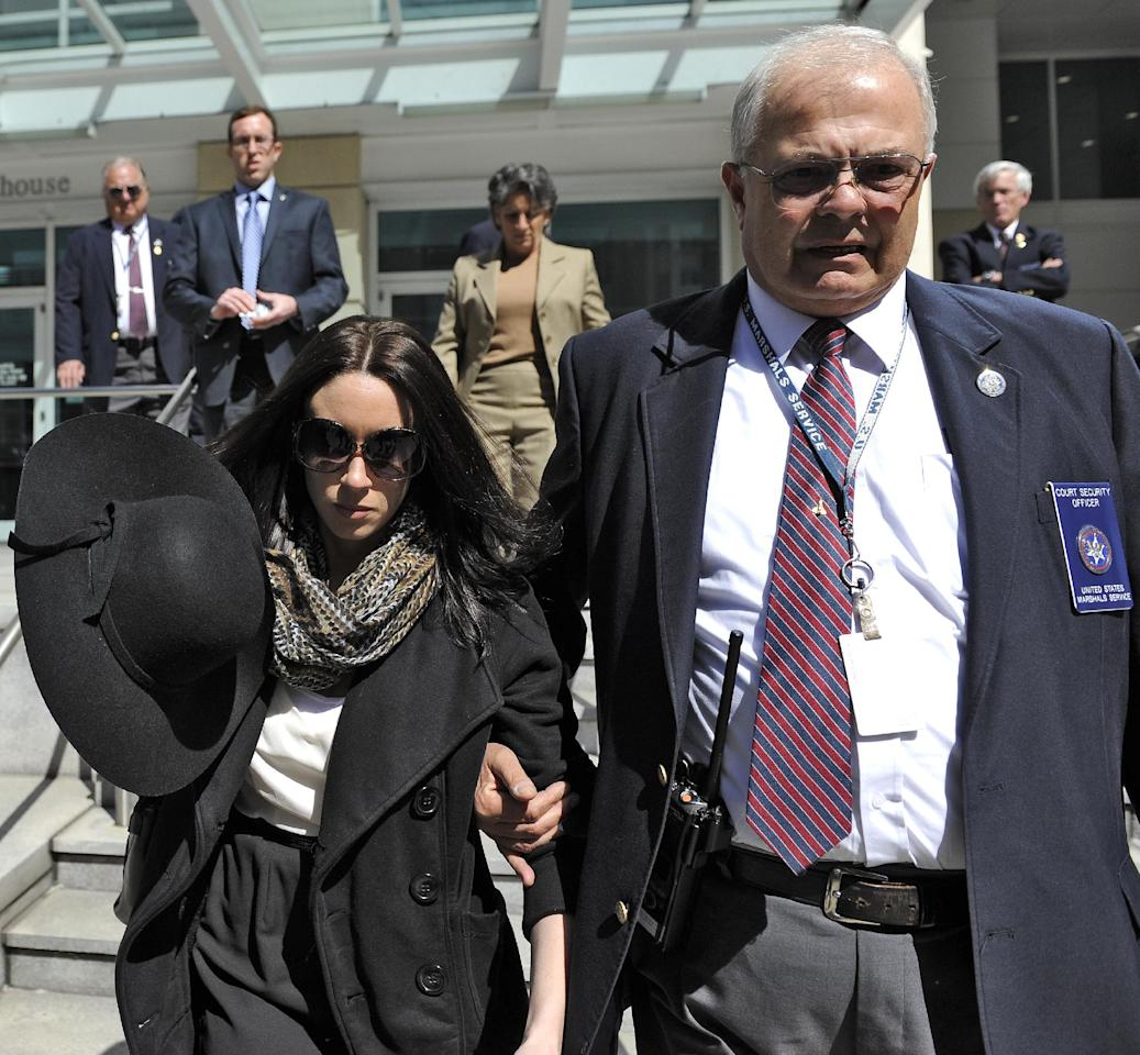 Casey Anthony leaves the federal courthouse in Tampa, with a U.S. Marshal after a bankruptcy hearing Monday, March 4, 2013. Anthony, 26, has not made any public appearances since she left jail after being acquitted in the murder of her two-year-old daughter Caylee. She filed for bankruptcy in Florida in late January, claiming about $1,000 in assets and $792,000 in liabilities. Court papers list Anthony as unemployed, with no recent income. (AP Photo/Brian Blanco)