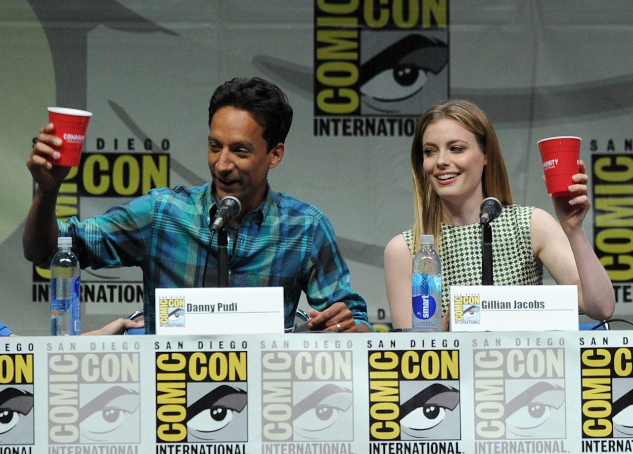 """SAN DIEGO, CA - JULY 21: Actors Danny Pudi (L) and Gillian Jacobs speak onstage at the """"Community"""" celebrating the fans during Comic-Con International 2013 at San Diego Convention Center on July 21, 2013 in San Diego, California. (Photo by Kevin Winter/Getty Images)"""