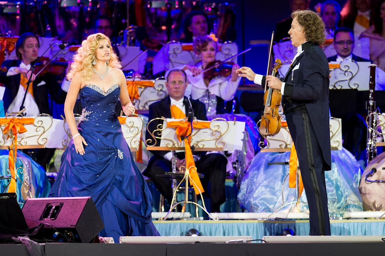 AMSTERDAM, NETHERLANDS - APRIL 30: Soprano Mirusia Louwerse and Andre Rieu perform on stage at Museumplien during the inauguration of King Willem Alexander of the Netherlands as Queen Beatrix of the Netherlands abdicates on April 30, 2013 in Amsterdam, Netherlands. (Photo by Ian Gavan/Getty Images)