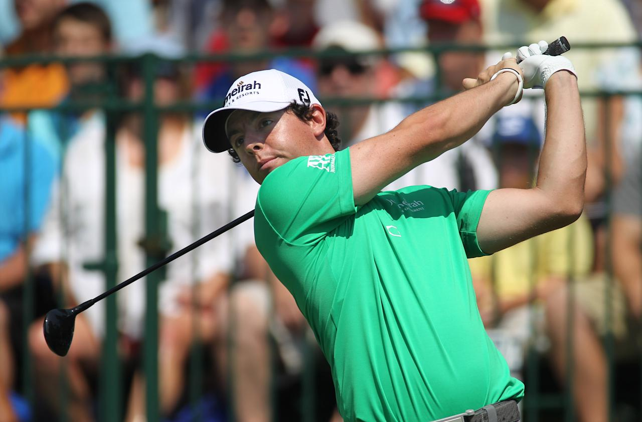 Rory McIlroy, from Northern Ireland, hits his tee shot on the first tee during the first round of the Deutsche Bank Championship golf tournament at TPC Boston in Norton, Mass., Friday, Aug. 31, 2012. (AP Photo/Stew Milne)