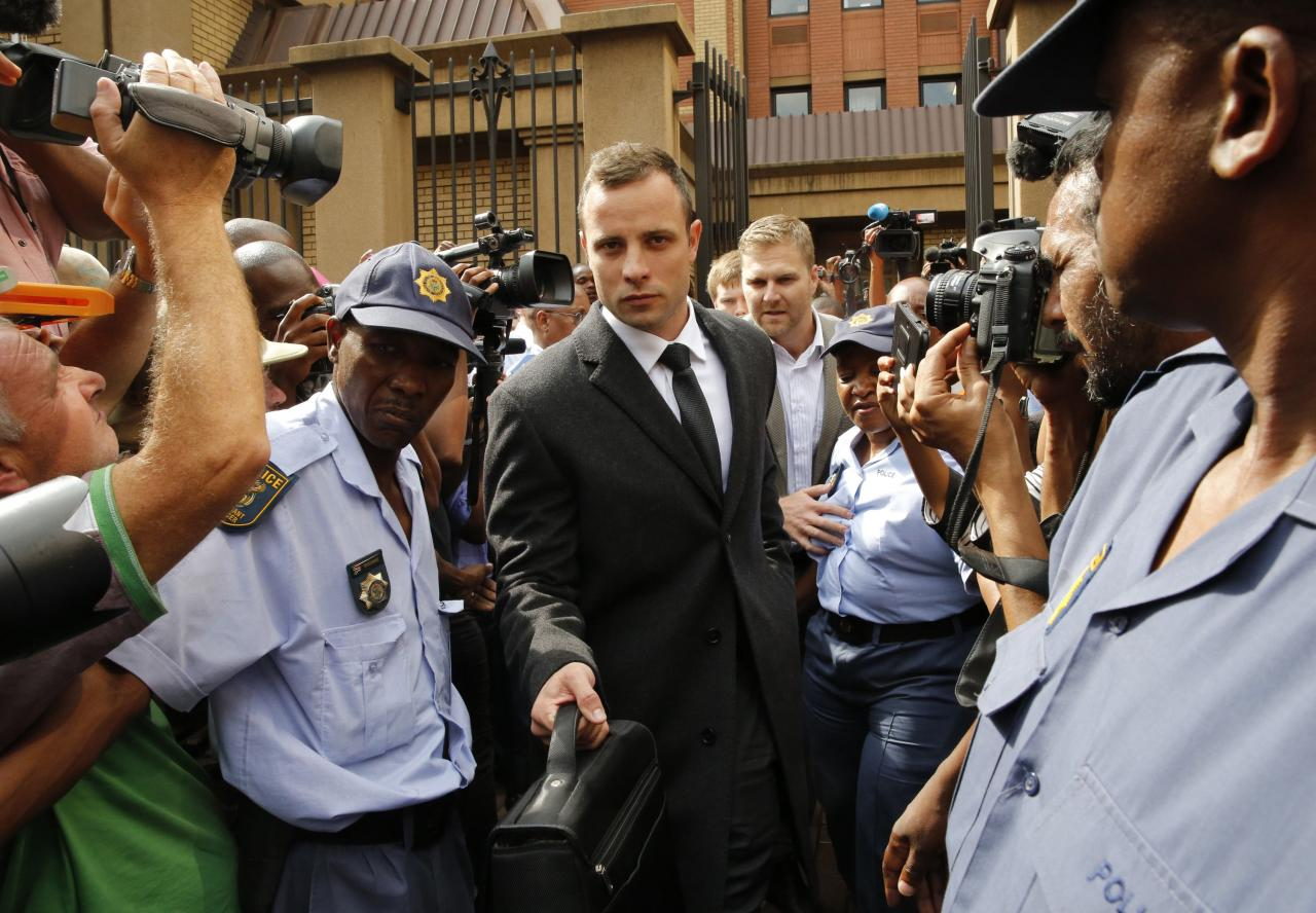 Olympic and Paralympic track star Oscar Pistorius leaves court after the fifth day of his trial for the murder of his girlfriend Reeva Steenkamp at the North Gauteng High Court in Pretoria, March 7, 2014. REUTERS/Mike Hutchings(SOUTH AFRICA - Tags: SPORT ATHLETICS CRIME LAW)