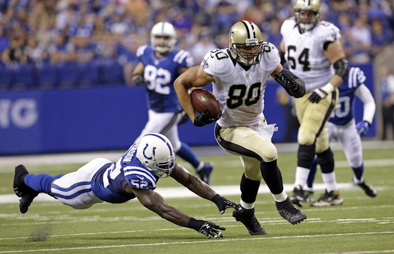 New Orleans Saints tight end Jimmy Graham (80) out runs the tackle of Indianapolis Colts inside linebacker D'Qwell Jackson during the first half of an NFL preseason football game in Indianapolis, Saturday, Aug. 23, 2014