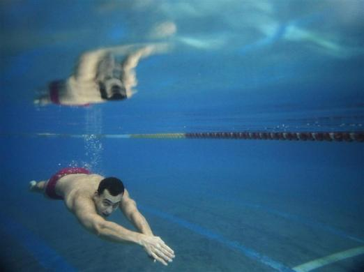 Hungarian swimmer Laszlo Cseh swims underwater during a training session in Budapest April 12, 2012.