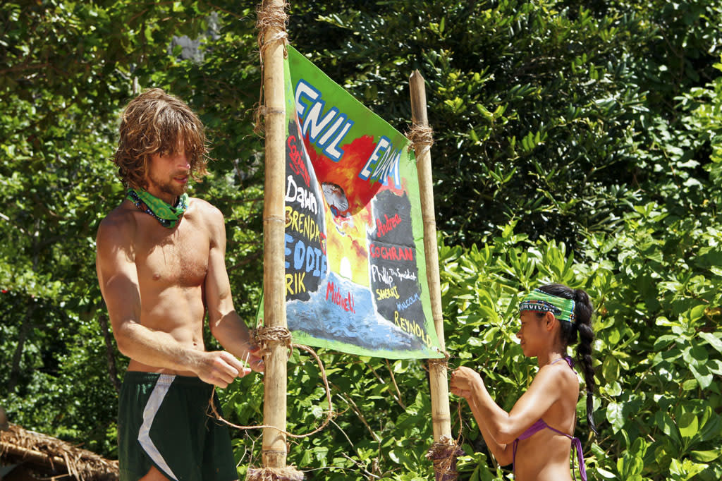 """""""Blindside Time"""" - Erik Reichenbach and Brenda Lowe hang up their new tribe flag during the eighth episode of """"Survivor: Caramoan - Fans vs. Favorites."""""""