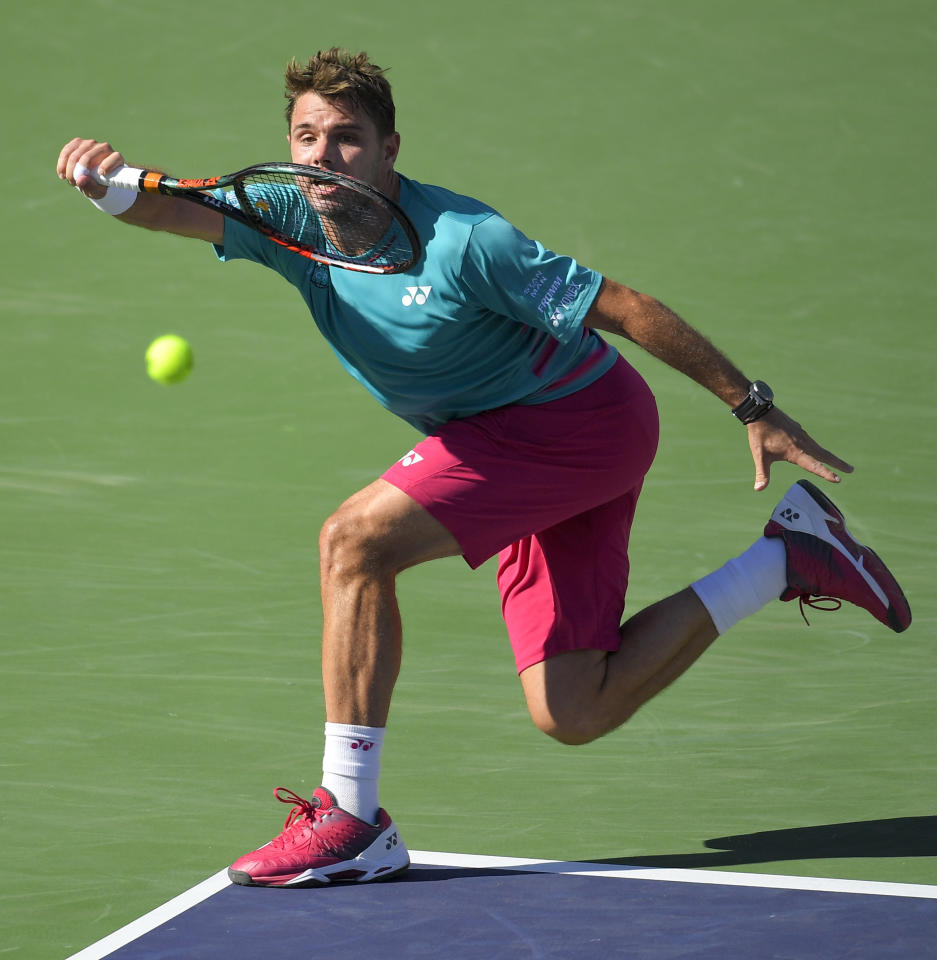 Stan Wawrinka, of Switzerland, hits to Roger Federer, of Switzerland, during the men's final at the BNP Paribas Open tennis tournament, Sunday, March 19, 2017, in Indian Wells, Calif. (AP Photo/Mark J. Terrill)