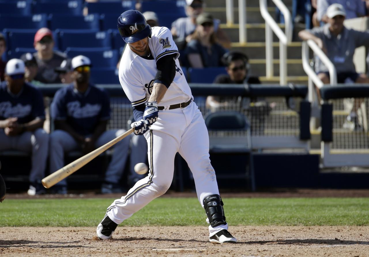 Milwaukee Brewers' Ryan Braun hits during an exhibition spring training baseball game against the San Diego Padres Friday, March 7, 2014, in Phoenix. (AP Photo/Morry Gash)