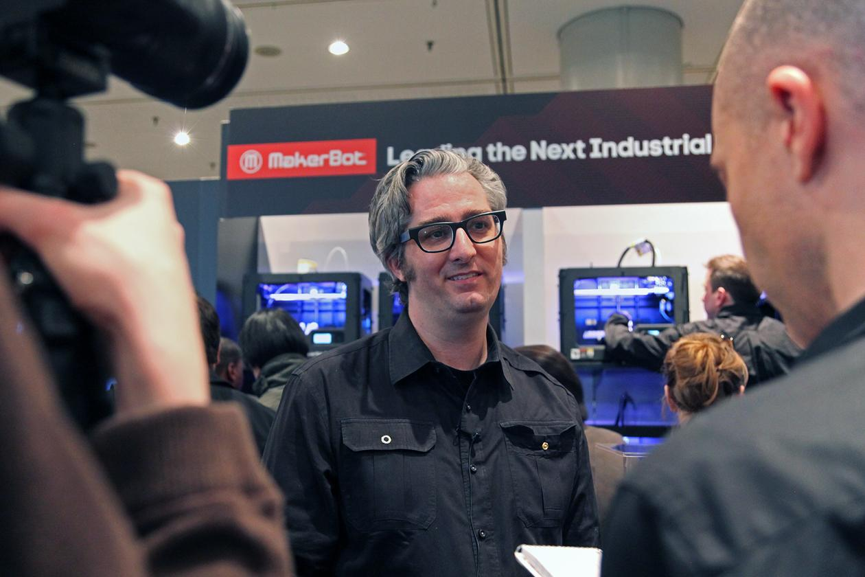 MakerBot's founder, Bre Pettis, brief reporters in front of display of MakerBot Replicator 2, their latest model of Desktop 3D printers.