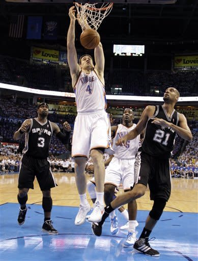 Oklahoma City Thunder forward Nick Collison (4) dunks as San Antonio Spurs guard Stephen Jackson (3), Thunder center Kendrick Perkins (5) and Spurs center Tim Duncan (21) watch during the first half of Game 4 in the NBA basketball playoffs Western Conference finals, Saturday, June 2, 2012, in Oklahoma City. (AP Photo/Eric Gay)