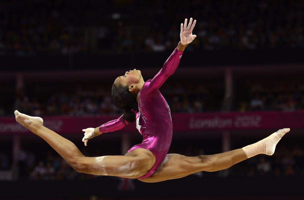 FILE PHOTO - Gabrielle Douglas of the U.S. competes in the balance beam during the women's individual all-around gymnastics final in the North Greenwich Arena during the London 2012 Olympic Games August 2, 2012.   REUTERS/Dylan Martinez/File photo