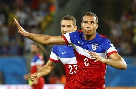 Brooks of the U.S. celebrates his goal against Ghana with Johnson during their 2014 World Cup Group G soccer match at the Dunas arena in Natal
