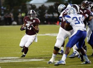 Middle Tennessee DB Jajuan Harley (36) tries to make a play on Mississippi State RB LaDarius Perkins in 2012. (AP)