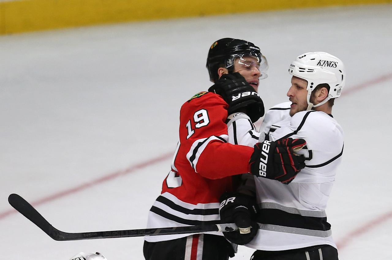 CHICAGO, IL - JUNE 02:  Jonathan Toews #19 of the Chicago Blackhawks and Kyle Clifford #13 of the Los Angeles Kings tussle after the play in the third period of Game Two of the Western Conference Final during the 2013 NHL Stanley Cup Playoffs at United Center on June 2, 2013 in Chicago, Illinois.  The Blackhawks defeated the Kings 4-2. (Photo by Jonathan Daniel/Getty Images)