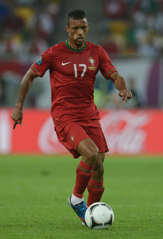 Portuguese midfielder Nani runs with the ball during  the Euro 2012 championships football match Germany vs Portugal  on June 9, 2012 at the Arena Lviv.     AFP PHOTO / PATRIK STOLLARZPATRIK STOLLARZ/AFP/GettyImages