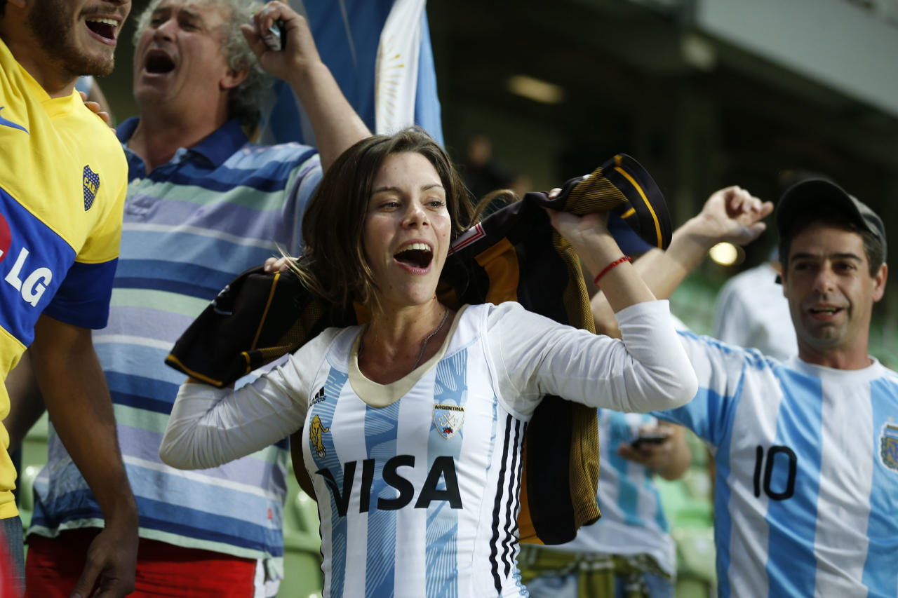 Argentine fans cheer for their team before the start of a training session at Independencia Stadium in Belo Horizonte, Brazil, Wednesday, June 11, 2014. Argentina will play in group F of the Brazil 2014 soccer World Cup. (AP Photo/Victor R. Caivano)