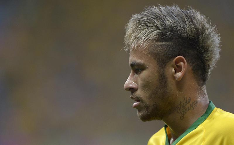 Brazil's Neymar pauses during the World Cup quarterfinal soccer match between Brazil and Colombia at the Arena Castelao in Fortaleza, Brazil, Friday, July 4, 2014