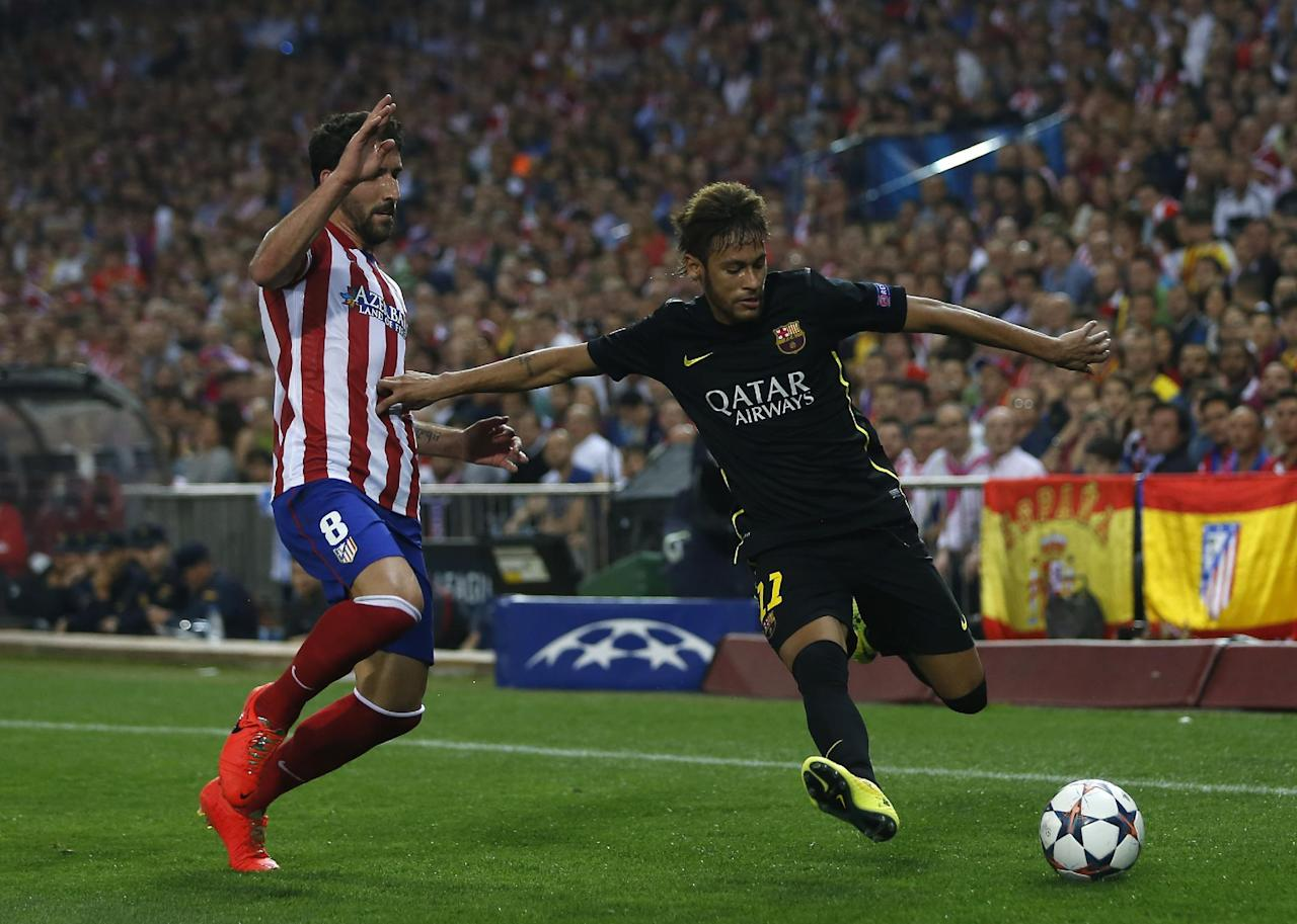 Atletico's Raul Garca fights for the ball with Barcelona's Neymar during the Champions League quarterfinal second leg soccer match between Atletico Madrid and FC Barcelona at the Vicente Calderon stadium in Madrid, Spain, Wednesday, April 9, 2014. (AP Photo/Andres Kudacki)