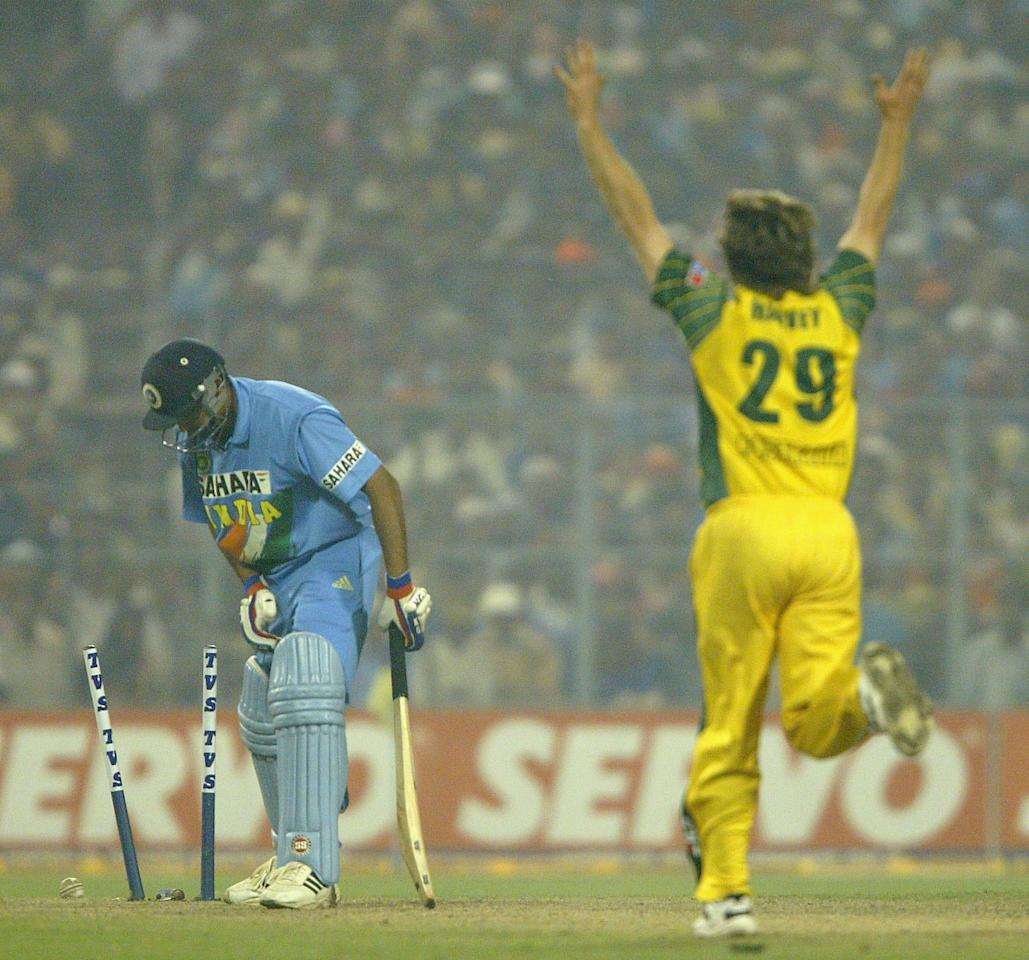 KOLKATA, INDIA - NOVEMBER 18:  Ian Harvey of Australia celebrates after taking bowling Zaheer Khan of India during the TVS Triangular One Day Series Final between India and Australia at Eden Gardens on November 18, 2003 in Kolkata, India. (Photo by Shaun Botterill/Getty Images)
