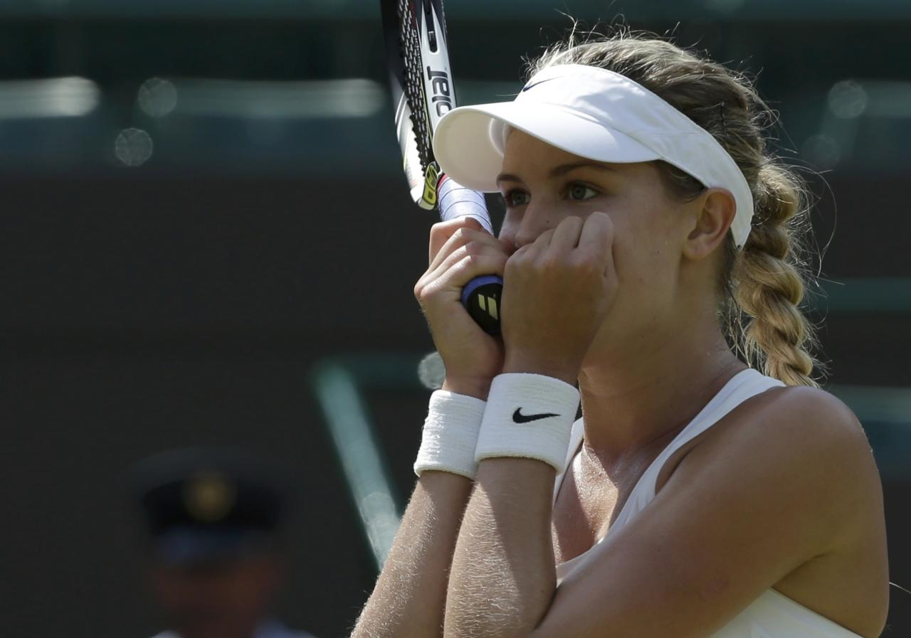 Eugenie Bouchard of Canada reacts after defeating Angelique Kerber of Germany in their women's singles quarter-final tennis match at the Wimbledon Tennis Championships, in London July 2, 2014. REUTERS/Max Rossi (BRITAIN - Tags: SPORT TENNIS)