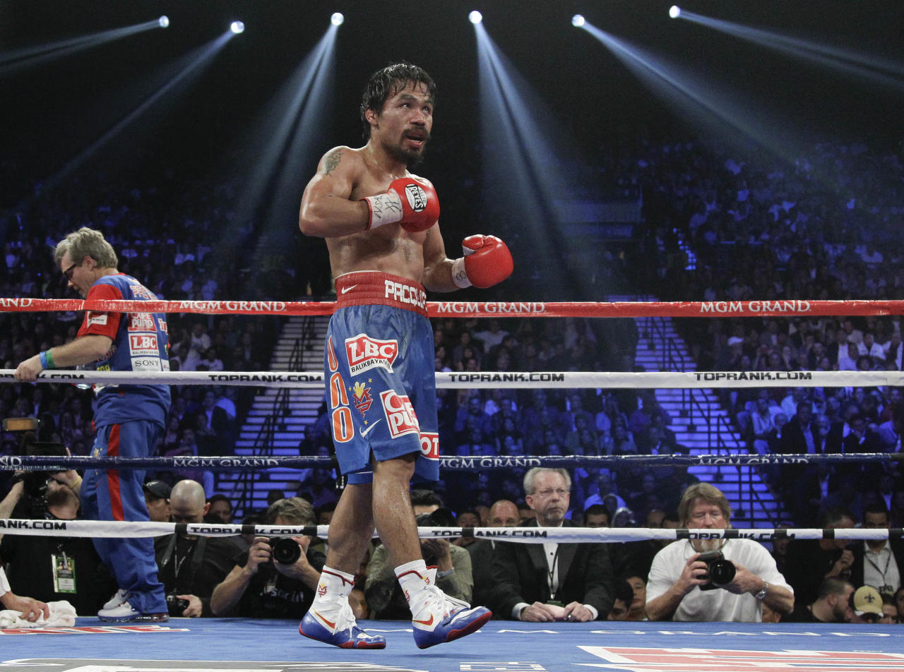 Manny Pacquiao walks out for the 11th round against Juan Manuel Marquez during a WBO welterweight title fight Saturday, Nov. 12, 2011, in Las Vegas. Pacquiao won by majority decision. (AP Photo/Julie Jacobson)