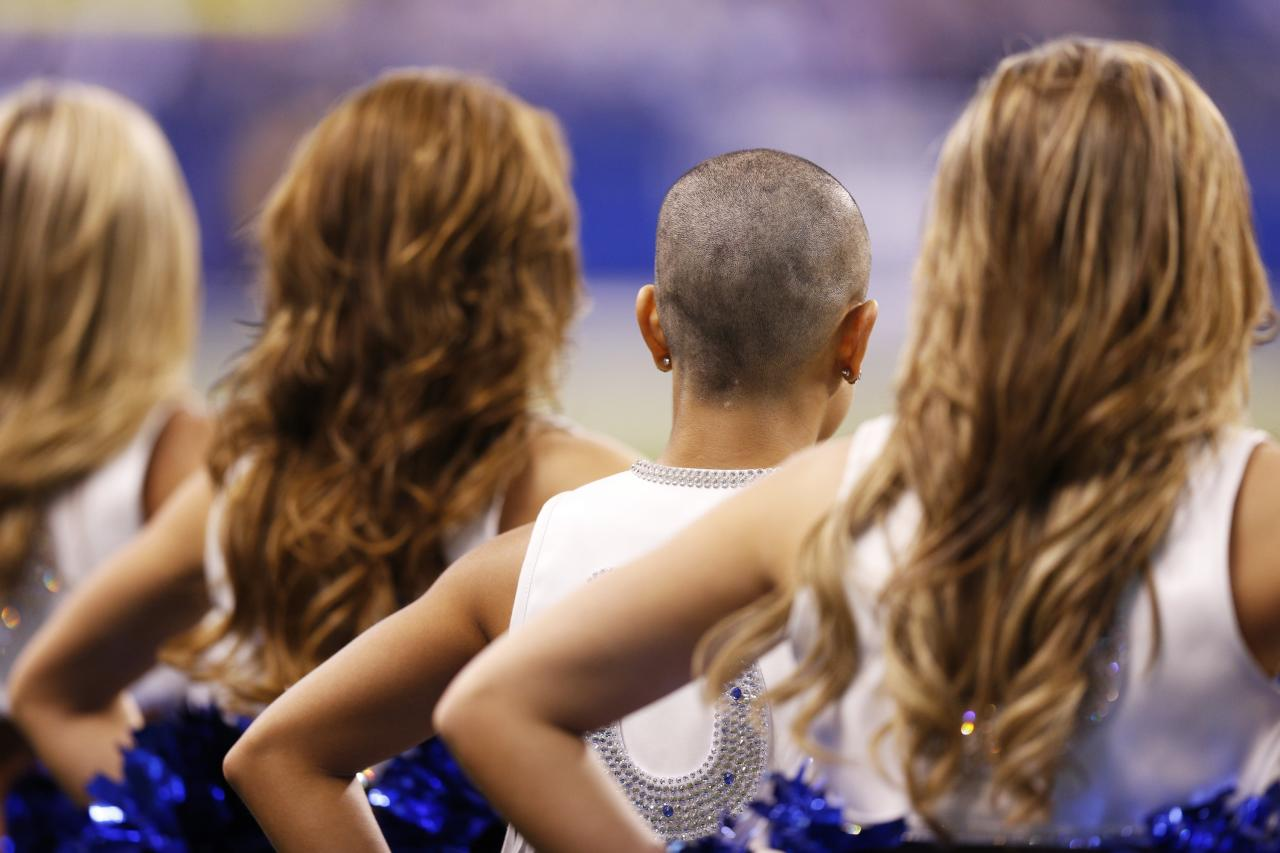 INDIANAPOLIS, IN - NOVEMBER 25: Indianapolis Colts cheerleader Crystal Ann stands with the rest of the squad after having her head shaved in support of head coach Chuck Pagano during the game against the Buffalo Bills at Lucas Oil Stadium on November 25, 2012 in Indianapolis, Indiana. The Colts won 20-13. (Photo by Joe Robbins/Getty Images)