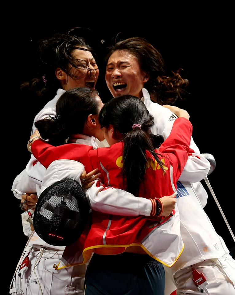 LONDON, ENGLAND - AUGUST 04:  Na Li, Xiaojuan Luo, Yujie Sun and Anqi Xu of China celebrate their 39-25 win over Korea during their Gold Medal Match in the Women's Epee Team Fencing Finals on Day 8 of the London 2012 Olympic Games at ExCeL on August 4, 2012 in London, England.  (Photo by Hannah Johnston/Getty Images)