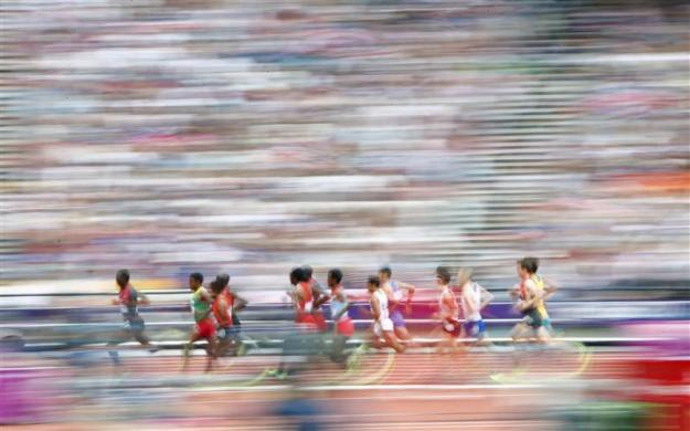 Athletes compete in their men's 5000m round 1 heat at the London 2012 Olympic Games at the Olympic Stadium August 8, 2012.