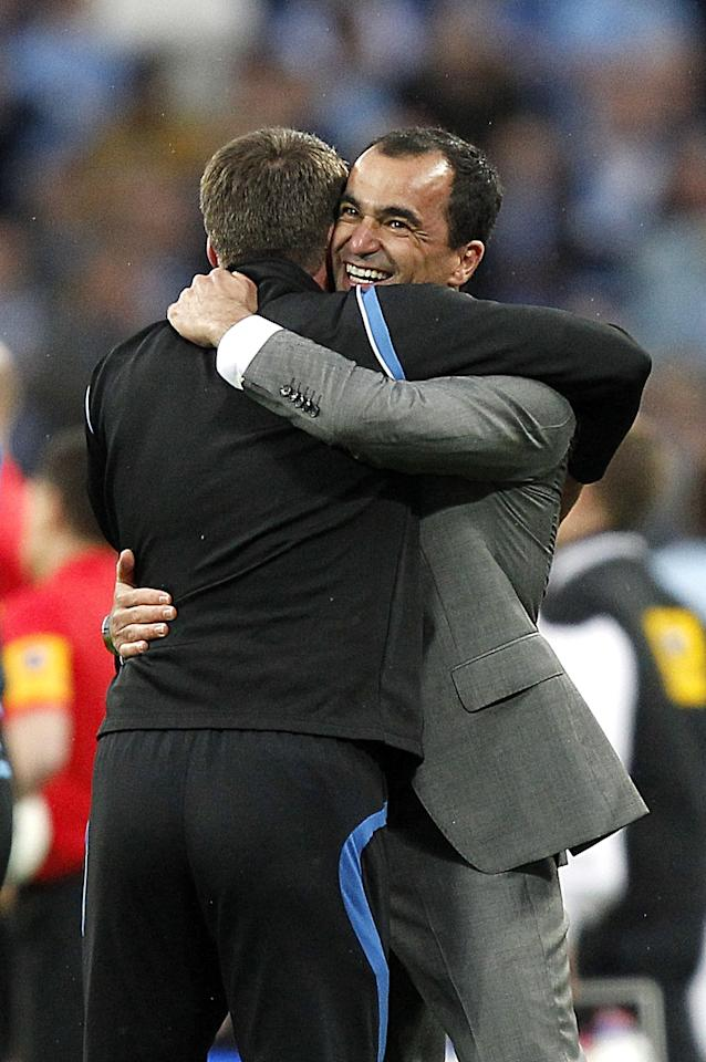 Wigan Athletic manager Roberto Martinez (right) celebrates winning the FA Cup final on the pitch after the game