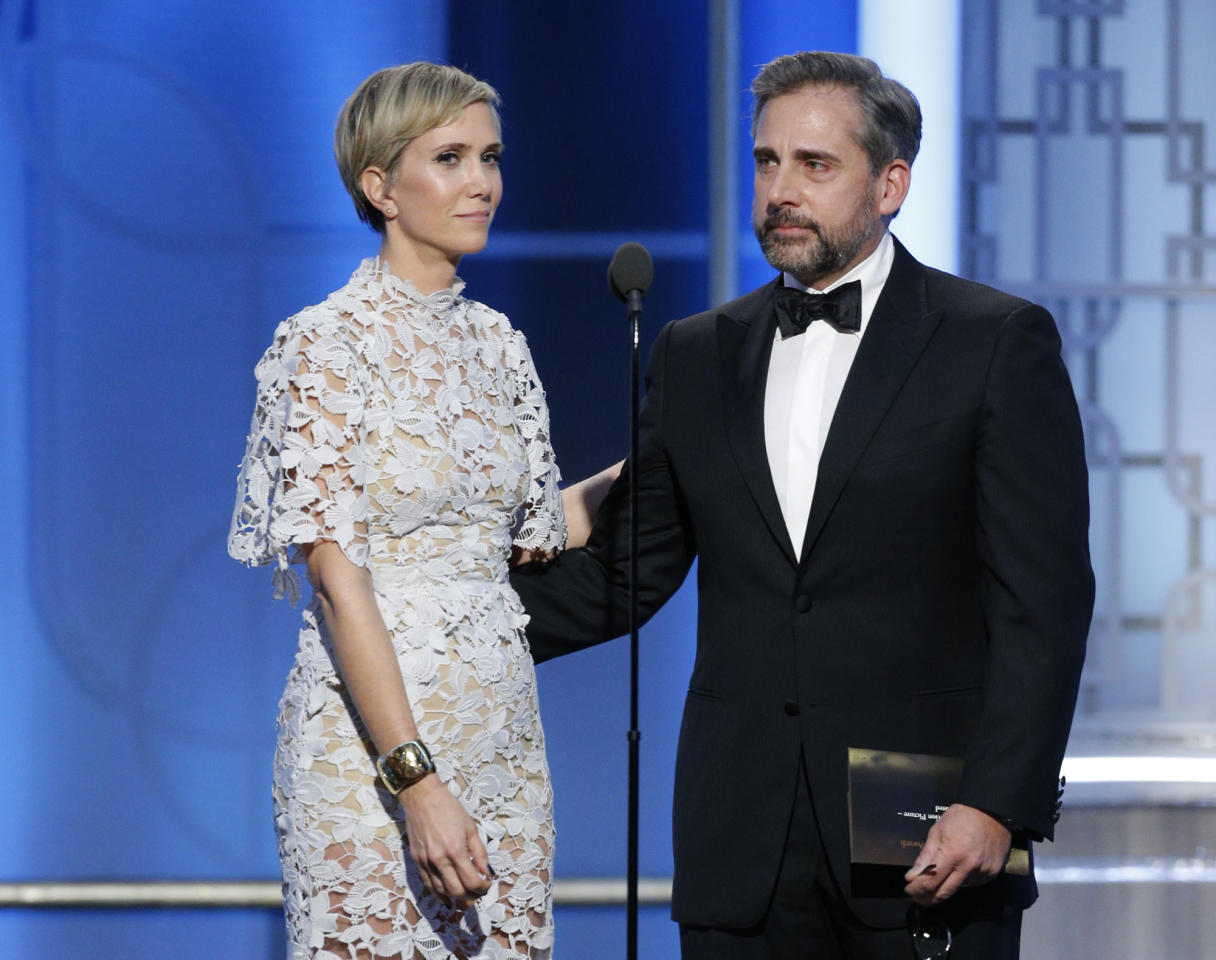 This image released by NBC shows presenters Kristen Wiig, left, and Steve Carell at the 74th Annual Golden Globe Awards at the Beverly Hilton Hotel in Beverly Hills, Calif., on Sunday, Jan. 8, 2017. (Paul Drinkwater/NBC via AP)