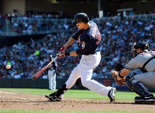 Morneau homers in 9th to lift Twins over Indians