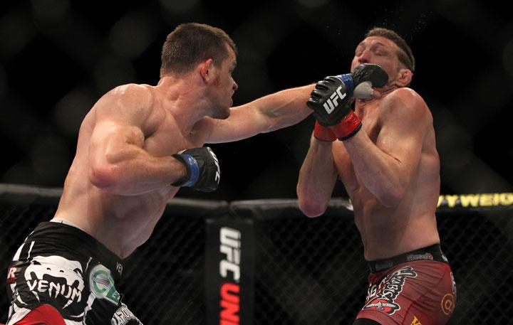 LAS VEGAS, NV - MAY 26:  CB Dollaway (left) punches Jason Miller during a middleweight bout at UFC 146 at MGM Grand Garden Arena on May 26, 2012 in Las Vegas, Nevada.