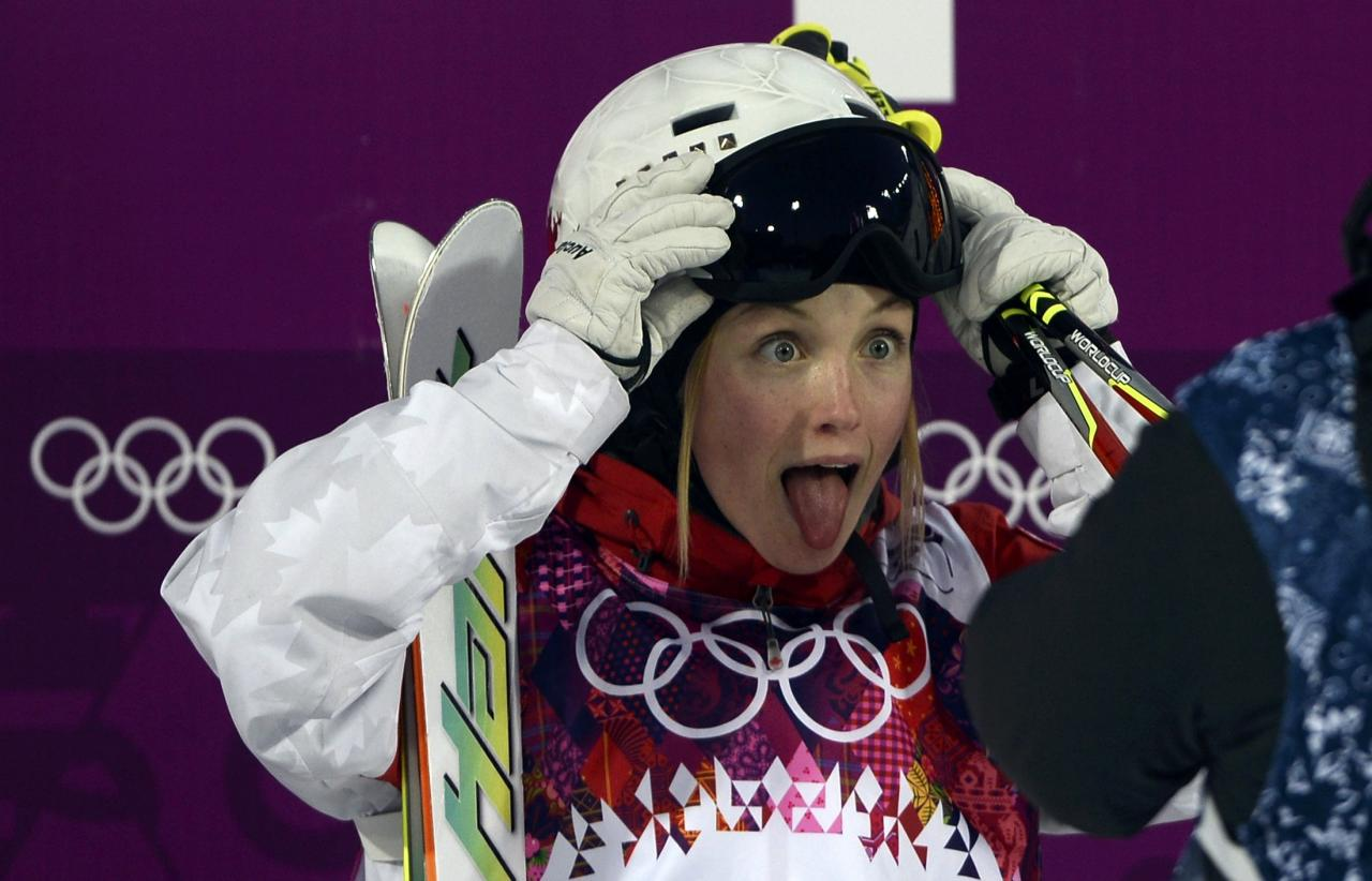 Canada's Chloe Dufour Lapointe reacts during the women's freestyle skiing moguls qualification round at the 2014 Sochi Olympic Games in Rosa Khutor February 6, 2014. REUTERS/Dylan Martinez (RUSSIA - Tags: SPORT OLYMPICS SPORT SKIING)