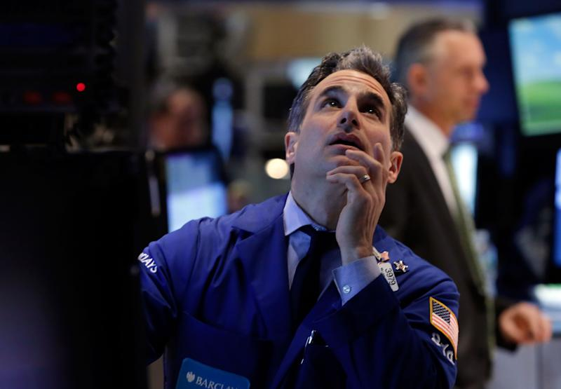 Stocks fall on jitters over earnings, tech rout