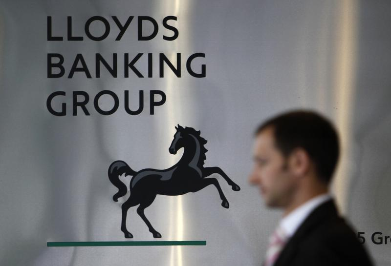 File photograph shows a pedestrian passing the head office of the Lloyds Banking Group in London