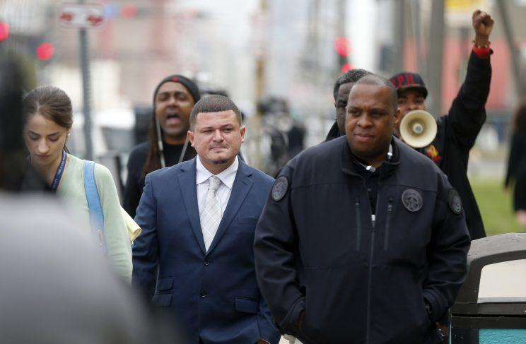 Richard Hernandez (middle) is followed and heckled by supporters of Cardell Hayes, after testifying in the murder trial of former Saint Will Smith. (AP)