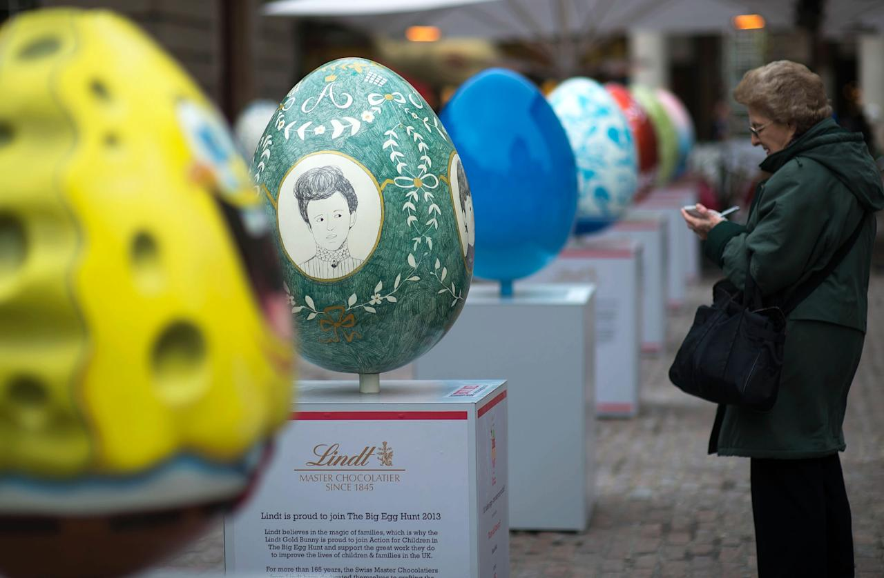 LONDON, ENGLAND - MARCH 22:  A giant fibreglass egg entitled 'Where Did Anna Go?' by Hanna Melin (Green egg) is displayed next to others in Covent Garden before the Big Egg Hunt on March 22, 2013 in London, England. Each egg is two and a half feet tall and designed by a leading artist.  (Photo by Bethany Clarke/Getty Images)