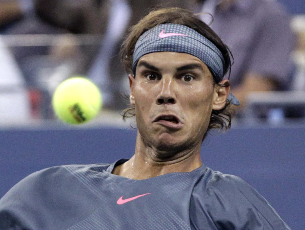 Rafael Nadal of Spain keeps his eyes on the ball as he plays Rogerio Dutra Silva of Brazil at the U.S. Open tennis championships in New York, August 29, 2013. REUTERS/Shannon Stapleton (UNITED STATES - Tags: SPORT TENNIS)