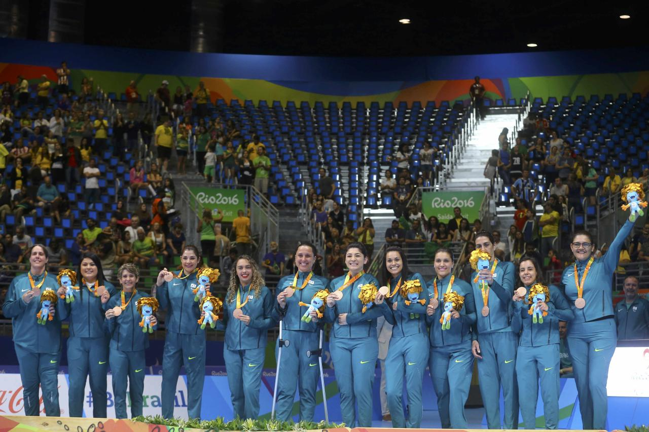 2016 Rio Paralympics - Sitting Volleyball - Victory Ceremony - Women's Gold Medal Match - Riocentro Pavilion 6 - Rio de Janeiro, Brazil, 17/09/2016. Members of team Brazil pose during the medal ceremony.  REUTERS/Pilar Olivares FOR EDITORIAL USE ONLY. NOT FOR SALE FOR MARKETING OR ADVERTISING CAMPAIGNS.
