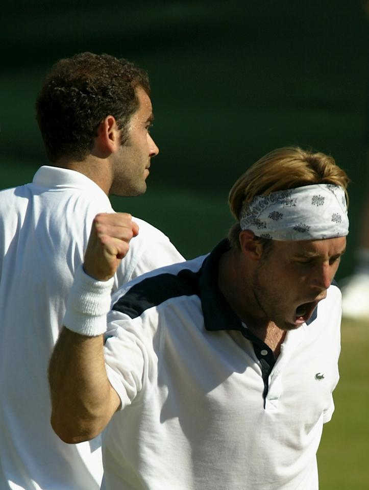 WIMBLEDON - June 26:  George Bastl of Switzerland celebrates after his victory over Pete Sampras of the USA  at the All England Tennis Championships at the All England Lawn Tennis Club, Wimbledon, England, on June 26, 2002. (Photo by Al Bello/Getty Images)