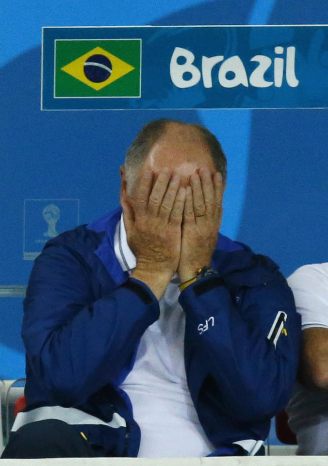 Brazil's coach Luiz Felipe Scolari reacts during his team's 2014 World Cup semi-finals against Germany at the Mineirao stadium in Belo Horizonte July 8, 2014. REUTERS/Ruben Sprich (BRAZIL - Tags: SOCCER SPORT WORLD CUP TPX IMAGES OF THE DAY)