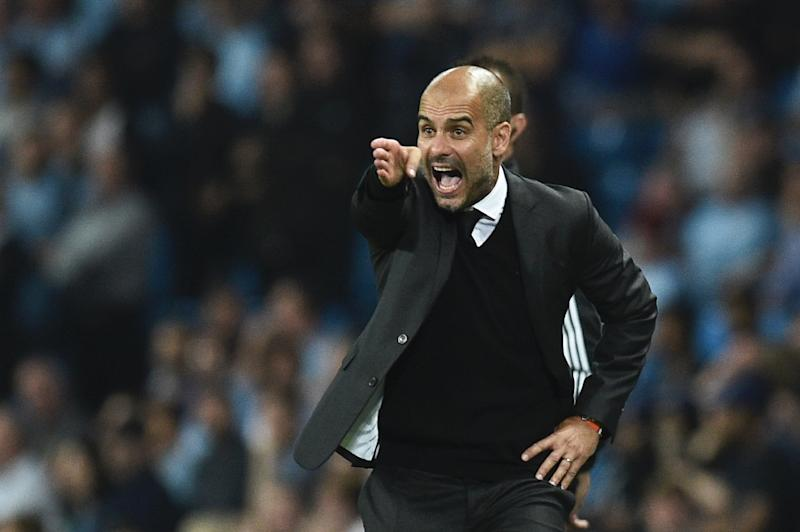 Manchester City's Spanish manager Pep Guardiola gesutres on the touchline during the UEFA Champions League group C football match between Manchester City and Borussia Monchengladbach