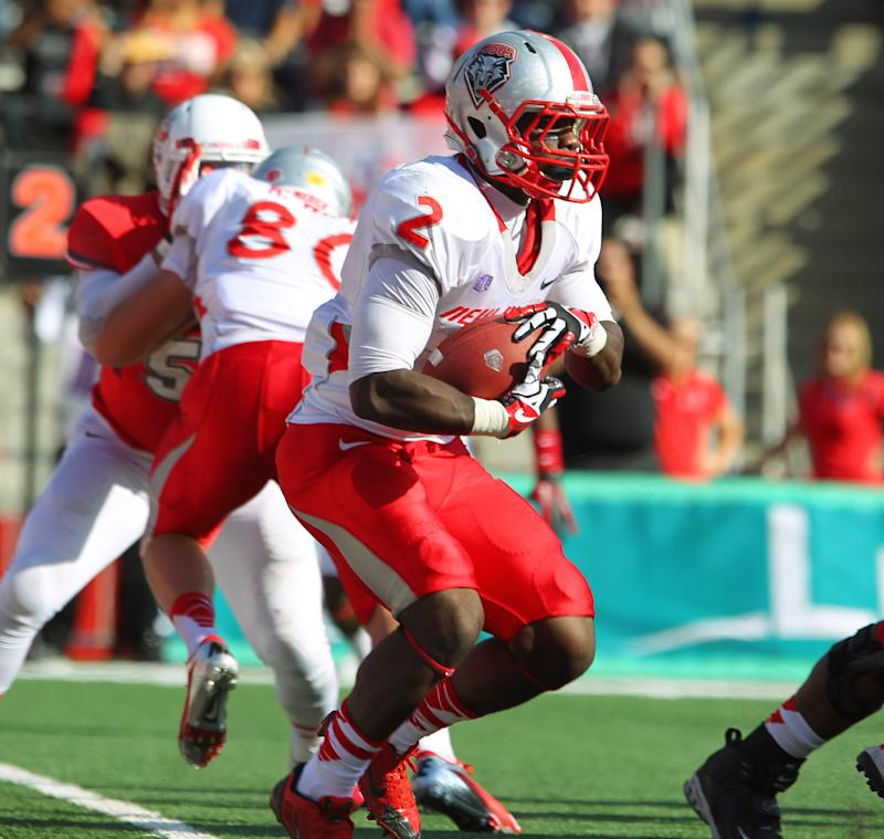 New Mexico's Crusoe Gongbay runs against Fresno State in the first half of an NCAA college football game in Fresno, Calif., Saturday, Nov. 23, 2013