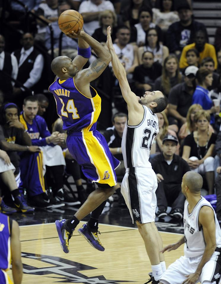 Los Angeles Lakers guard Kobe Bryant (24) shoots over San Antonio Spurs guard Manu Ginobili, of Argentina, during the first half of an NBA basketball game on Friday, April 20, 2012 in San Antonio. (AP Photo/Bahram Mark Sobhani)