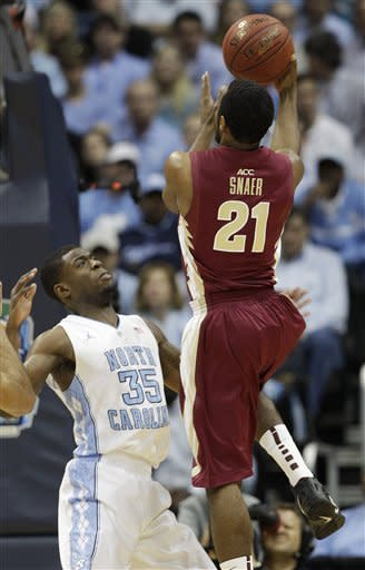 Florida State guard Michael Snaer (21) shoots over North Carolina Tar Heels guard Reggie Bullock (35) during the first half of an NCAA college basketball game in the finals of the Atlantic Coast Conference tournament,  Sunday, March 11, 2012, in Atlanta. (AP Photo/Chuck Burton)