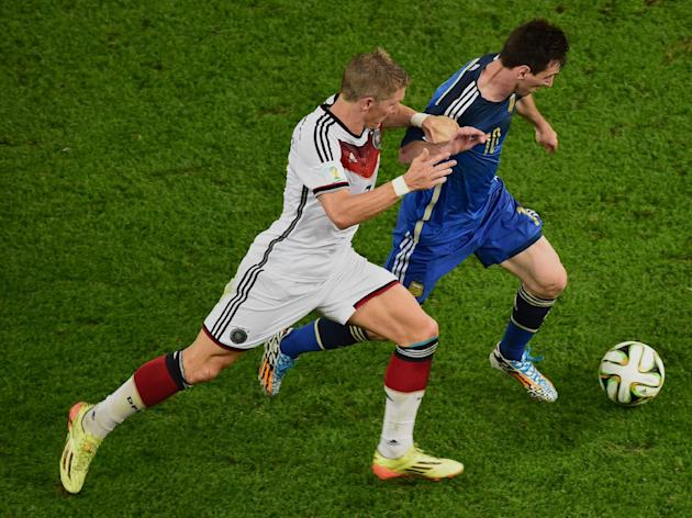 Argentina's Lionel Messi, right, and Germany's Bastian Schweinsteiger vie for the ball during the World Cup final soccer match between Germany and Argentina at the Maracana Stadium in Rio de Janeiro, Brazil, Sunday, July 13, 2014. (AP Photo/Francois Xavier Marit, Pool)