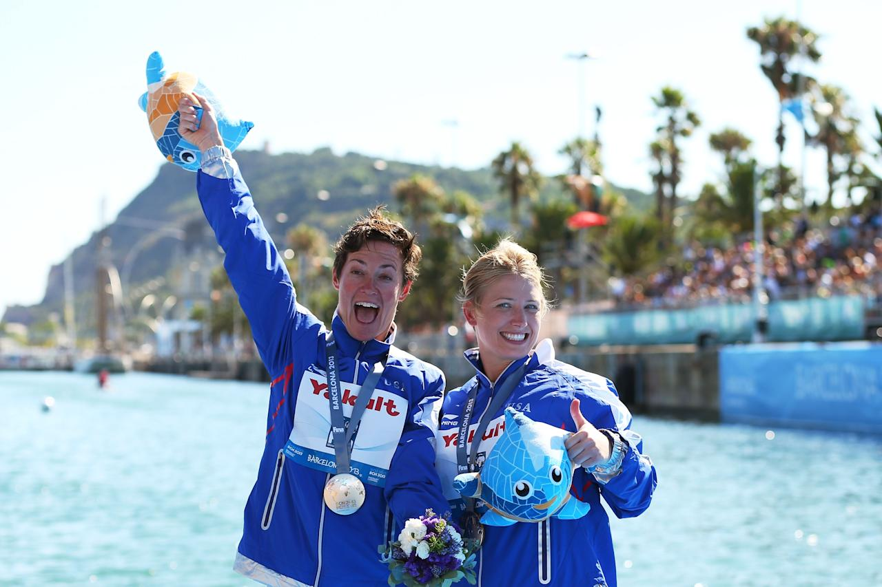 BARCELONA, SPAIN - JULY 30: (L-R) Silver medal winner Ginger Huber of USA and Gold medal winner Cesilie Carlton of the USA celebrate after the Women's 20m High Diving on day eleven of the 15th FINA World Championships at Moll de la Fusta on July 30, 2013 in Barcelona, Spain. (Photo by Quinn Rooney/Getty Images)
