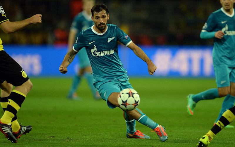 Zenit's Portuguese midfielder Miguel Danny (C) plays the ball during the last 16 second-leg UEFA Champions League football match Borussia Dortmund vs Zenit St Petersburg in Dortmund, western Germany on March 19, 2014