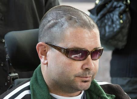 San Francisco Giants fan Bryan Stow is pushed out of a Los Angeles Court in a wheelchair