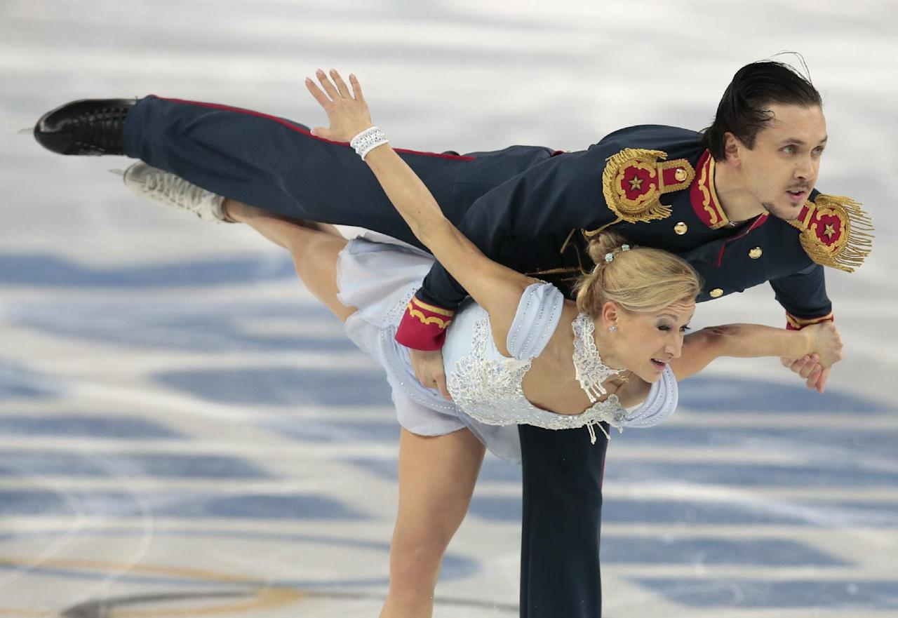 Tatiana Volosozhar and Maxim Trankov of Russia compete in the pairs short program figure skating competition at the Iceberg Skating Palace during the 2014 Winter Olympics, Tuesday, Feb. 11, 2014, in Sochi, Russia. (AP Photo/Ivan Sekretarev)